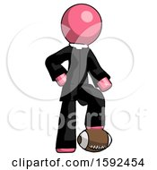 Pink Clergy Man Standing With Foot On Football