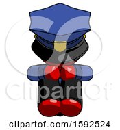 Red Police Man Sitting With Head Down Facing Forward