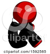Red Clergy Man Sitting With Head Down Facing Sideways Right