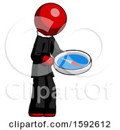 Red Clergy Man Looking At Large Compass Facing Right