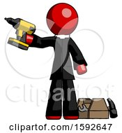 Red Clergy Man Holding Drill Ready To Work Toolchest And Tools To Right