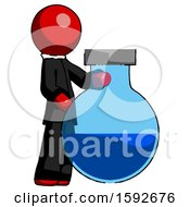 Red Clergy Man Standing Beside Large Round Flask Or Beaker