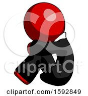 Red Clergy Man Sitting With Head Down Facing Sideways Left