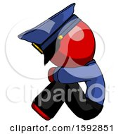 Red Police Man Sitting With Head Down Facing Sideways Left
