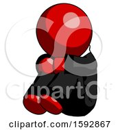 Red Clergy Man Sitting With Head Down Facing Angle Left
