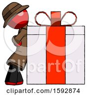 Red Detective Man Gift Concept Leaning Against Large Present