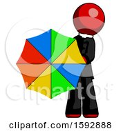 Red Clergy Man Holding Rainbow Umbrella Out To Viewer