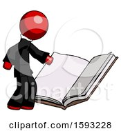 Red Clergy Man Reading Big Book While Standing Beside It