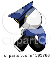 White Police Man Sitting With Head Down Facing Sideways Left