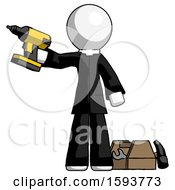 White Clergy Man Holding Drill Ready To Work Toolchest And Tools To Right