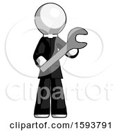 White Clergy Man Holding Large Wrench With Both Hands