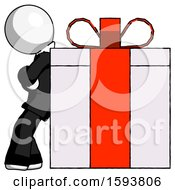 White Clergy Man Gift Concept Leaning Against Large Present