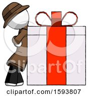 White Detective Man Gift Concept Leaning Against Large Present
