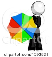 White Clergy Man Holding Rainbow Umbrella Out To Viewer