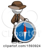 White Detective Man Standing Beside Large Compass