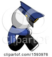 White Police Man Sitting With Head Down Facing Sideways Right