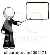 White Clergy Man Giving Presentation In Front Of Dry Erase Board