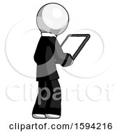 White Clergy Man Looking At Tablet Device Computer Facing Away