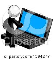 White Clergy Man Using Large Laptop Computer