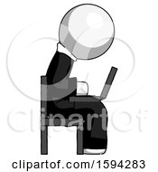 White Clergy Man Using Laptop Computer While Sitting In Chair View From Side