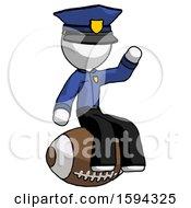 White Police Man Sitting On Giant Football