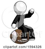 White Clergy Man Sitting On Giant Football