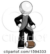White Clergy Man Standing With Foot On Football