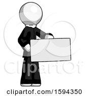 White Clergy Man Presenting Large Envelope
