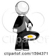 White Clergy Man Frying Egg In Pan Or Wok