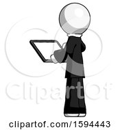 White Clergy Man Looking At Tablet Device Computer With Back To Viewer