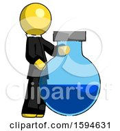 Yellow Clergy Man Standing Beside Large Round Flask Or Beaker