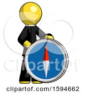 Yellow Clergy Man Standing Beside Large Compass