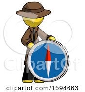 Yellow Detective Man Standing Beside Large Compass