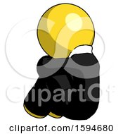 Yellow Clergy Man Sitting With Head Down Back View Facing Left