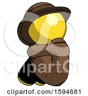 Yellow Detective Man Sitting With Head Down Back View Facing Left