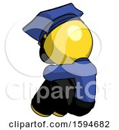 Yellow Police Man Sitting With Head Down Back View Facing Left