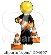 Yellow Clergy Man Holding A Traffic Cone