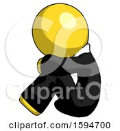 Yellow Clergy Man Sitting With Head Down Facing Sideways Left