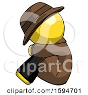 Yellow Detective Man Sitting With Head Down Facing Sideways Left
