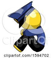 Yellow Police Man Sitting With Head Down Facing Sideways Left
