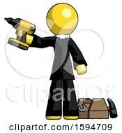 Yellow Clergy Man Holding Drill Ready To Work Toolchest And Tools To Right
