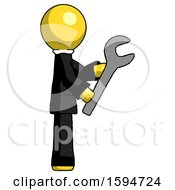 Yellow Clergy Man Using Wrench Adjusting Something To Right