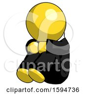 Yellow Clergy Man Sitting With Head Down Facing Angle Left