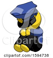 Yellow Police Man Sitting With Head Down Facing Angle Left
