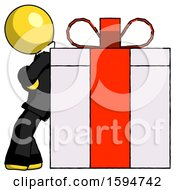 Yellow Clergy Man Gift Concept Leaning Against Large Present