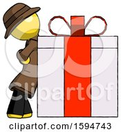 Yellow Detective Man Gift Concept Leaning Against Large Present