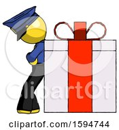 Yellow Police Man Gift Concept Leaning Against Large Present