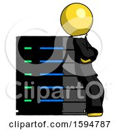 Yellow Clergy Man Resting Against Server Rack Viewed At Angle