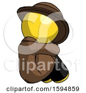 Yellow Detective Man Sitting With Head Down Back View Facing Right