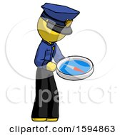 Yellow Police Man Looking At Large Compass Facing Right